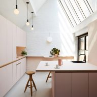 "GRT Architects creates New York office with millennial-pink kitchen and dark ""nap room"""