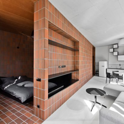 Terracotta Toned Tiles Divide Vilnius Apartment Into Two Contrasting Halves