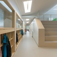 NL Architects completes Belgian school featuring low-lying rooms surrounded by a colonnade