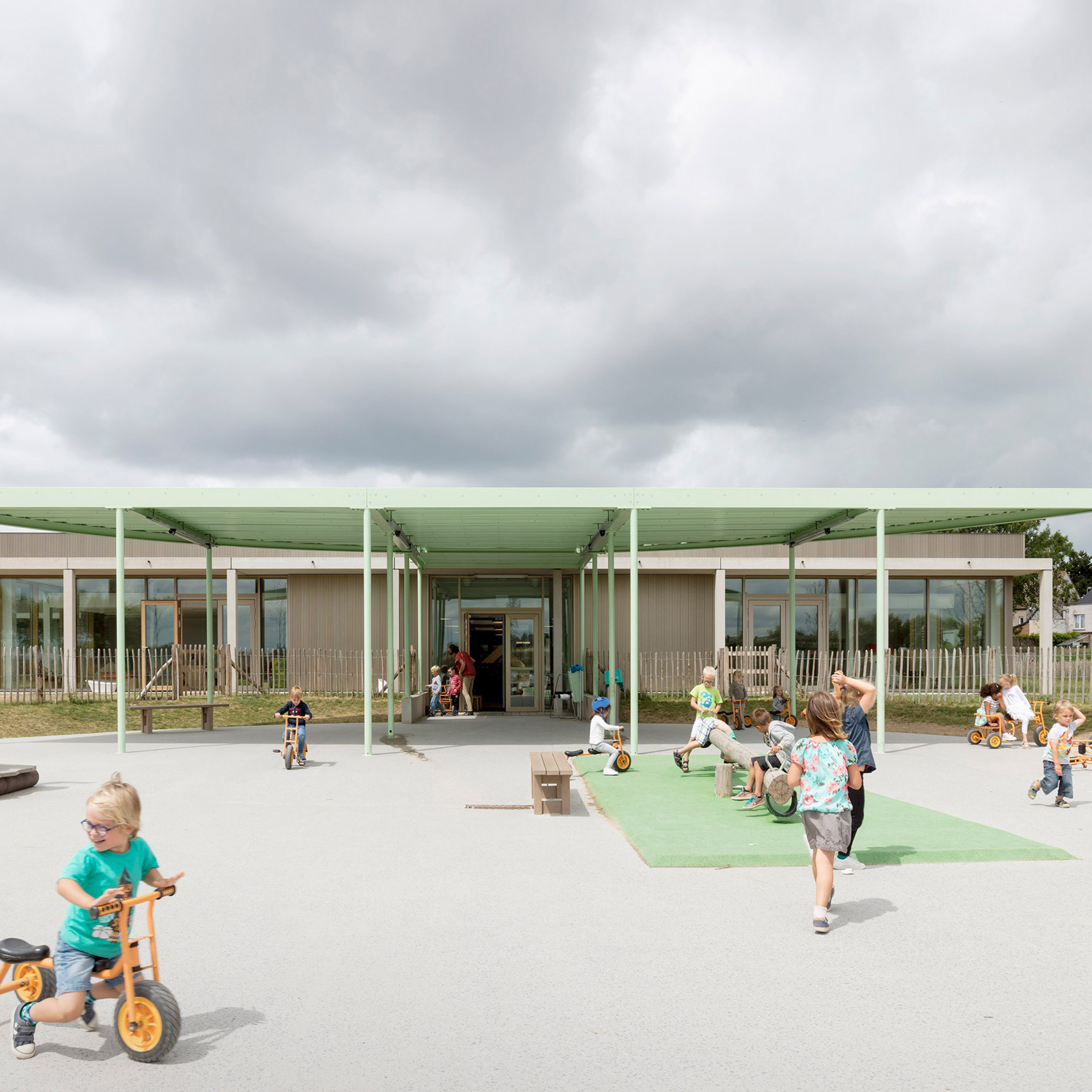 NL Architects Completes Belgian School Featuring A Colonnade And A  Pyramidal Roof