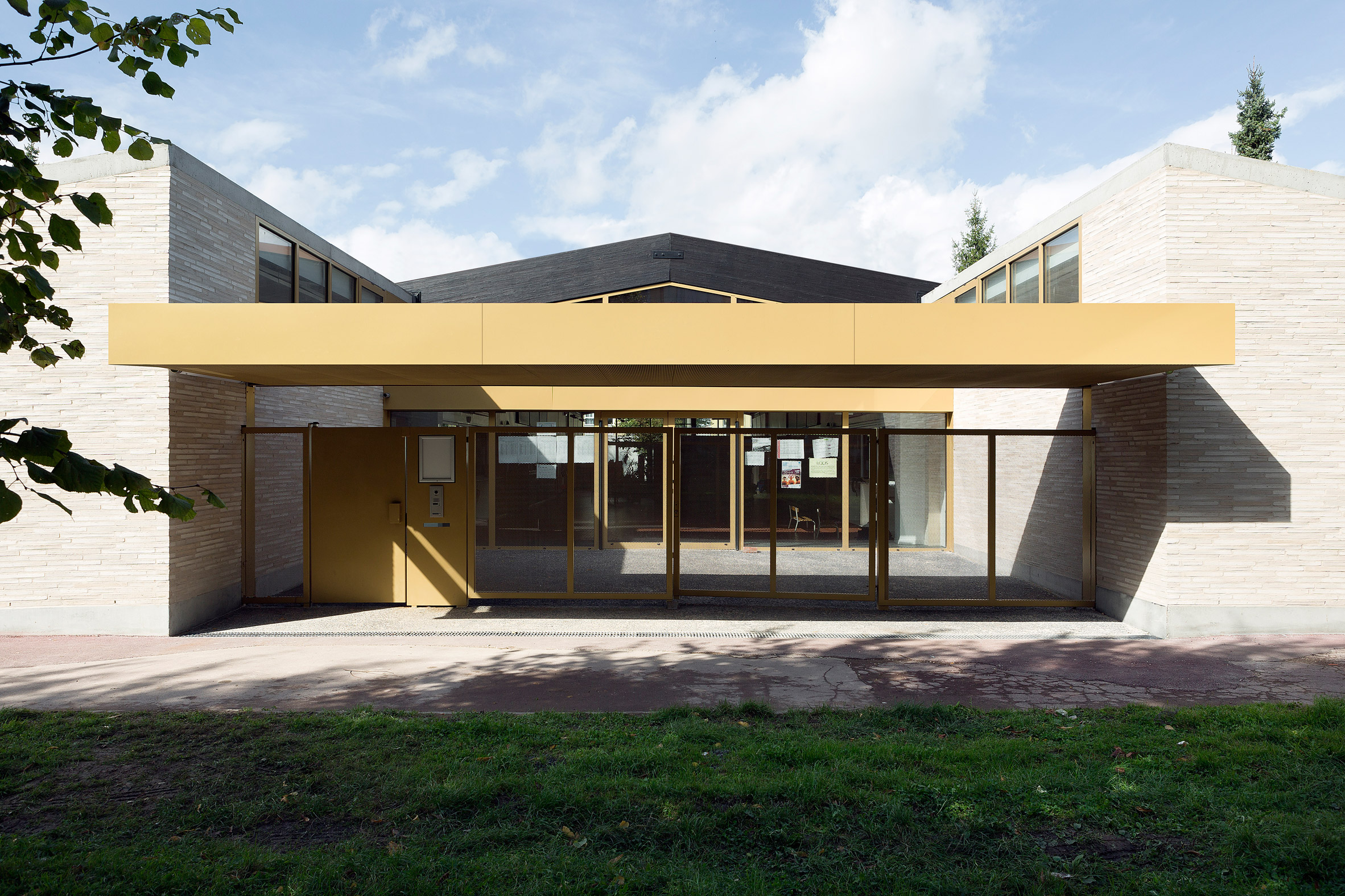 Lille school extension by LT2A features porthole-like windows and golden details