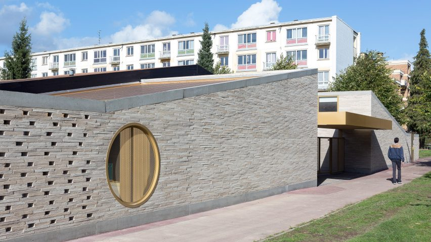 Lille school extension by lt a has porthole windows and golden details