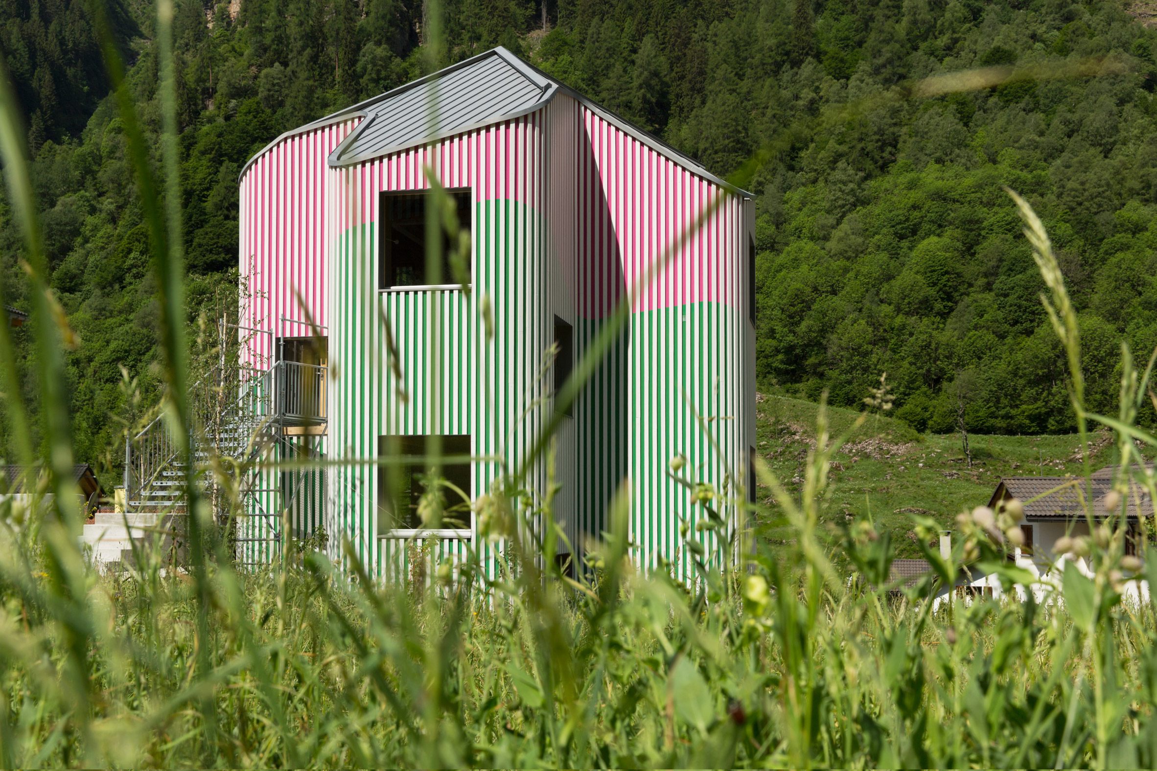 Green and pink stripes colour undulating walls of Swiss house