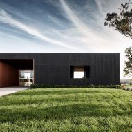 Those Architects extends former dairy farm with black-stained sales office