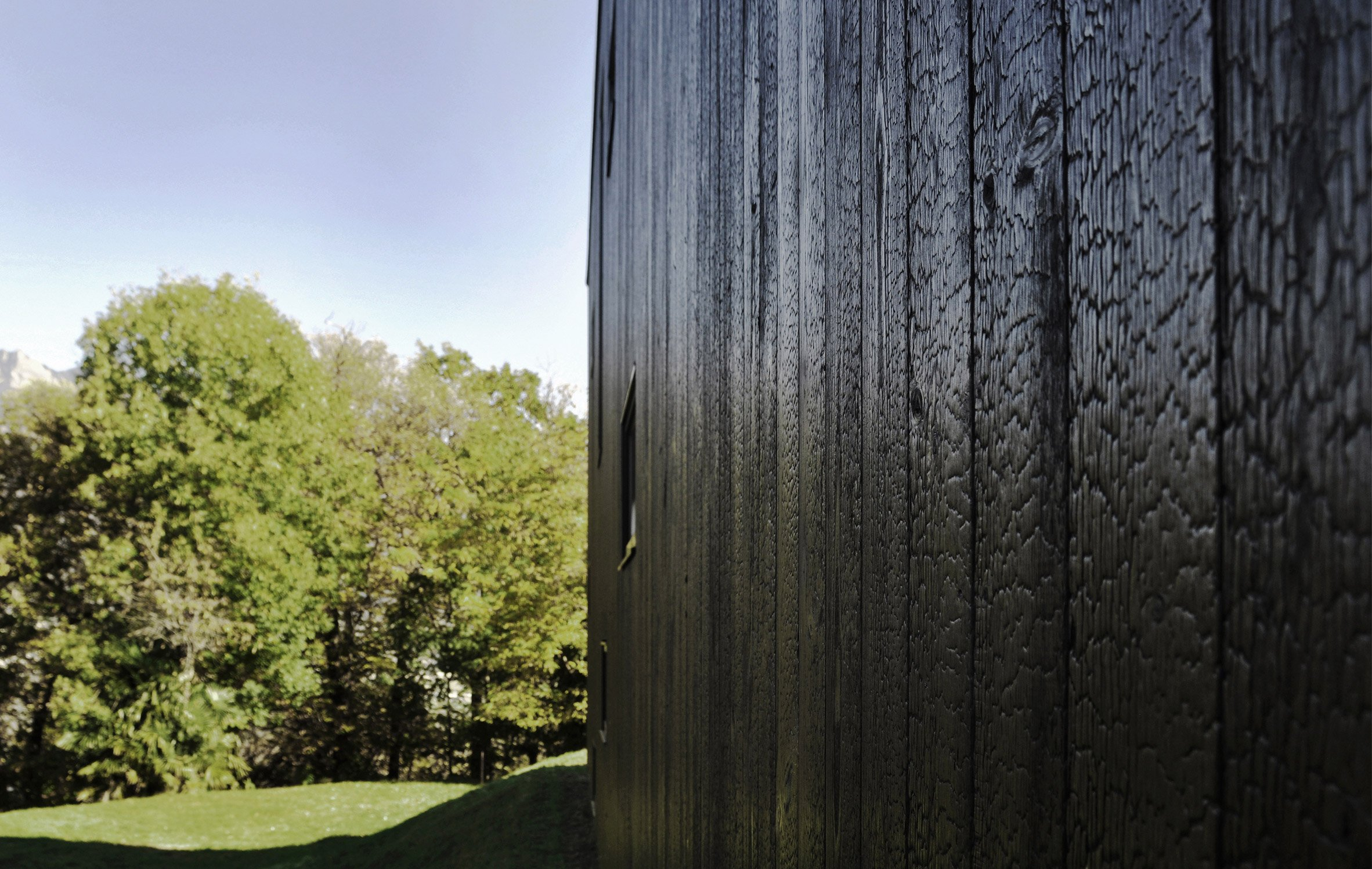 THEWOODBUILDING is a prefabricated wooden holiday home clad in charred timber boards by designers Nicole Lachelle and Christian Niessen