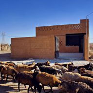 Sprayed render covers walls of rural Iranian house by BAM Architects Office