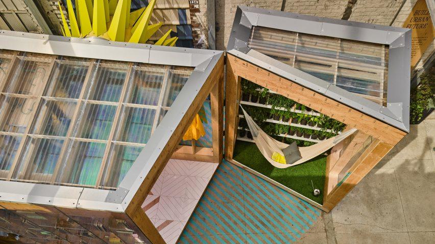 Bureau v adds playful appendages to mini living urban cabin
