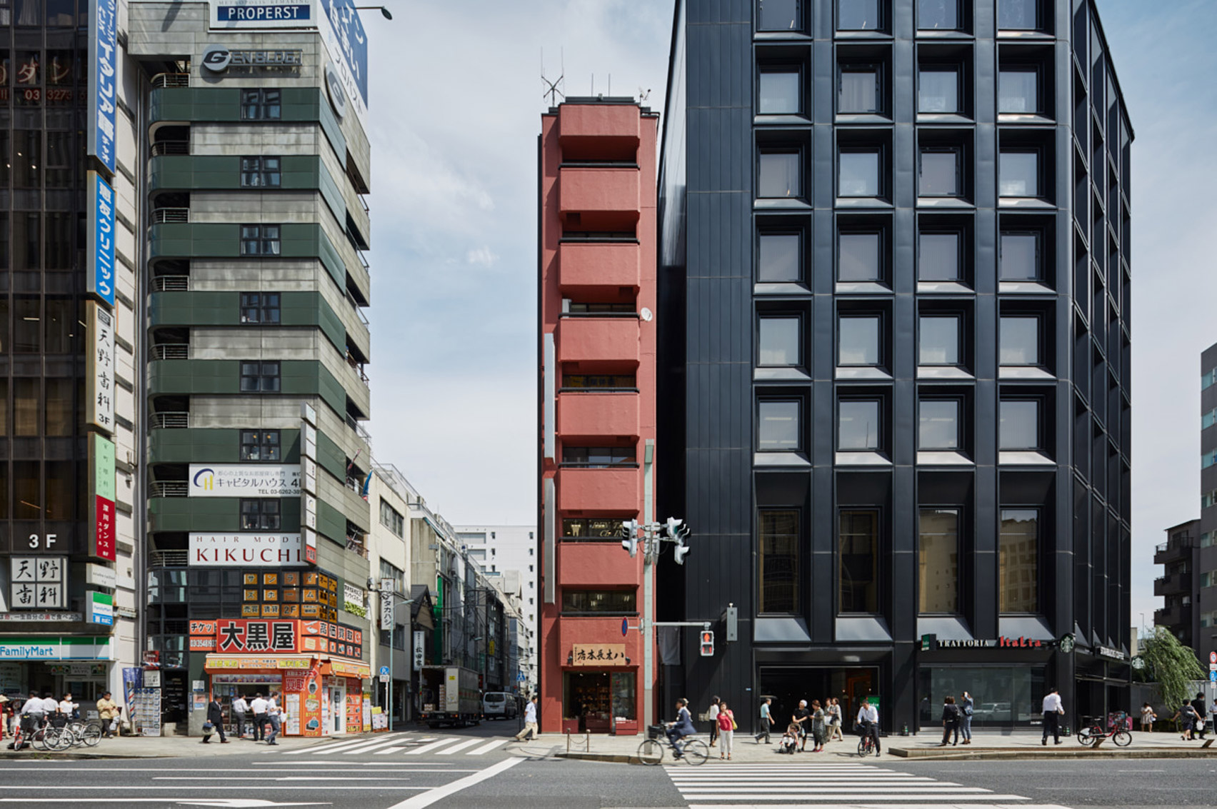 Schemata Architects creates red-toned interior for Tokyo grocery store inside skinny tower