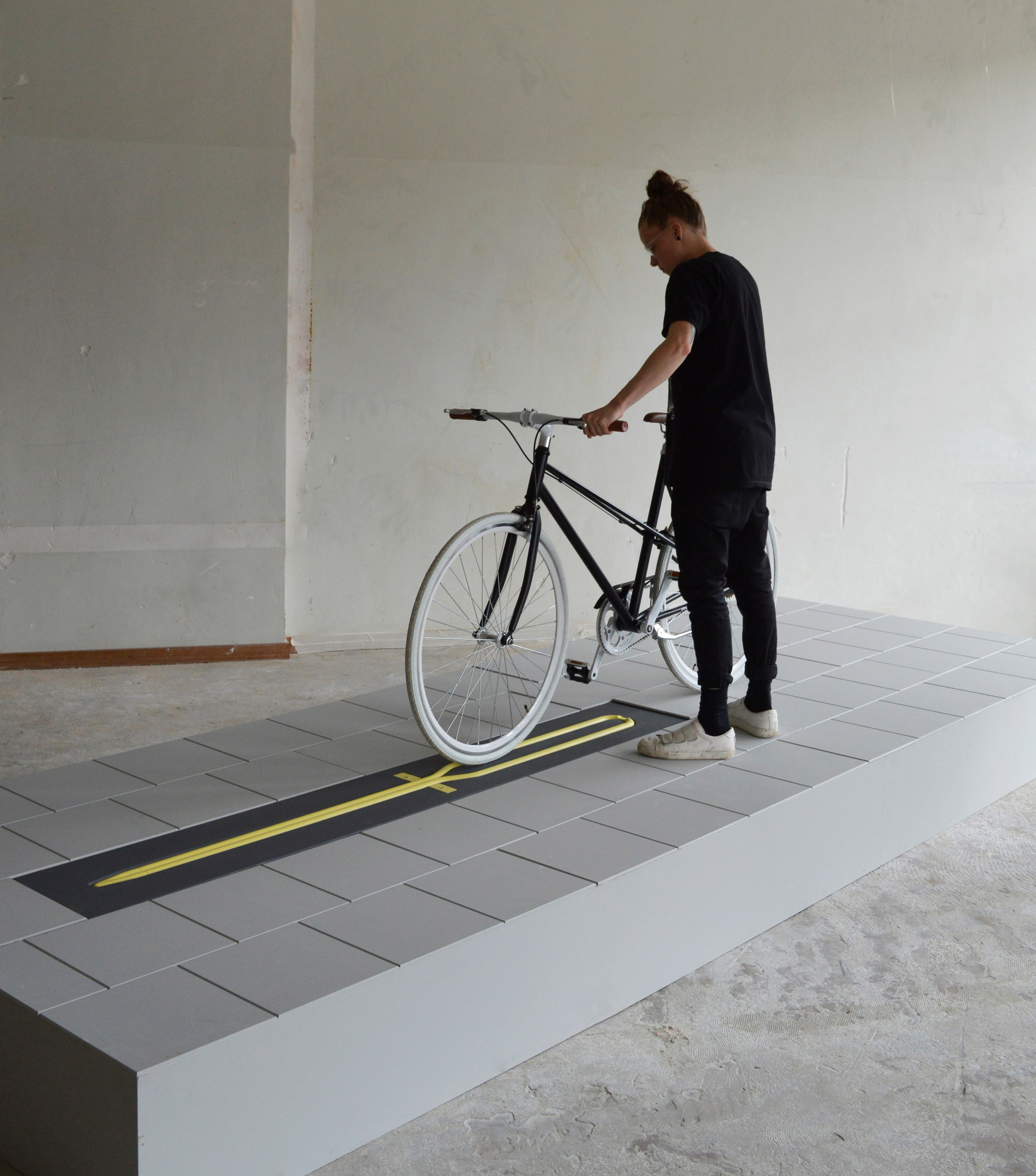 Milou Bergs' bicycle rack disappears into the pavement when not in use