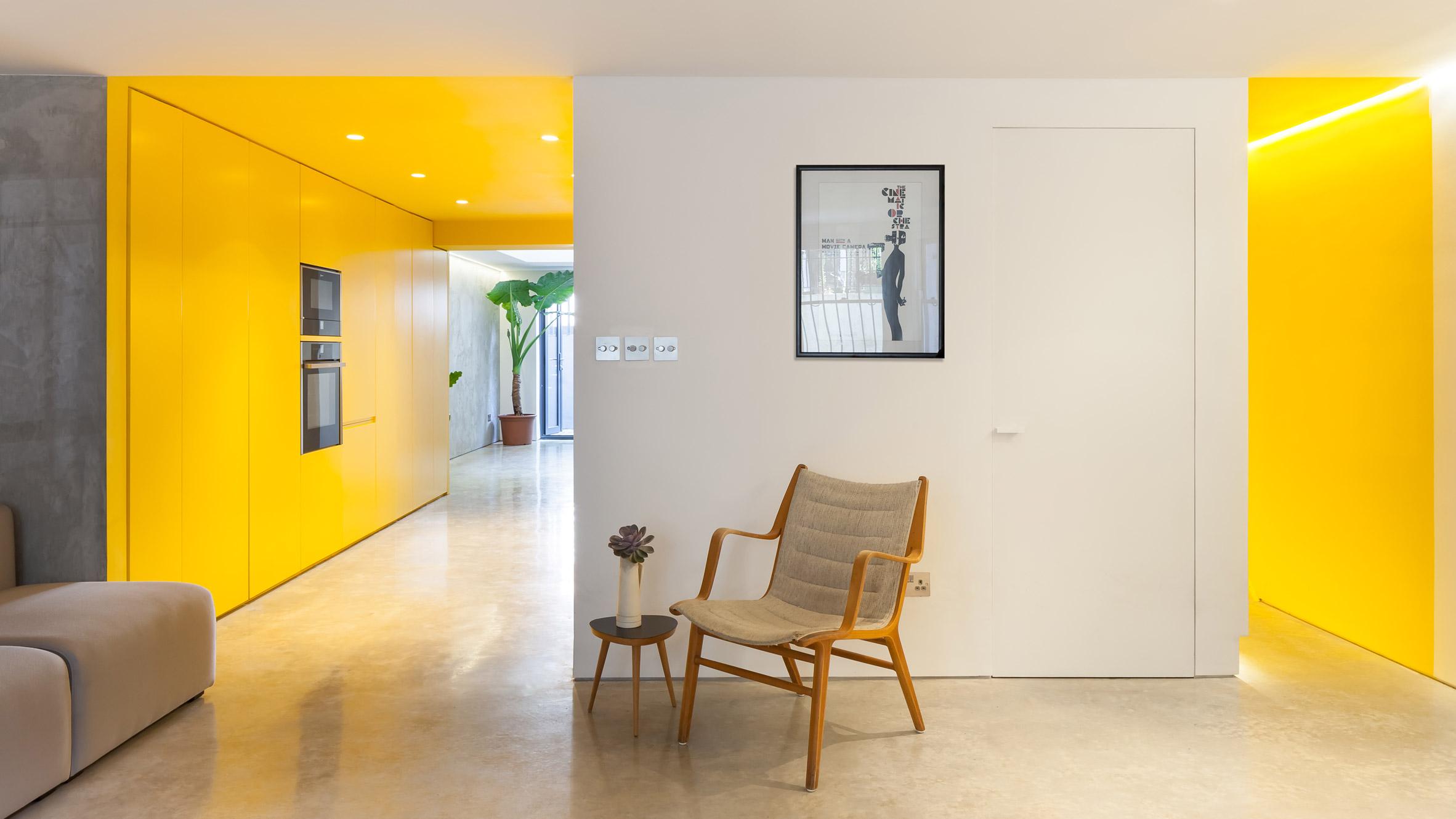 Vibrant Yellow Kitchen Brightens Basement Of North London Home