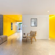 Vibrant yellow kitchen brightens basement of north London home