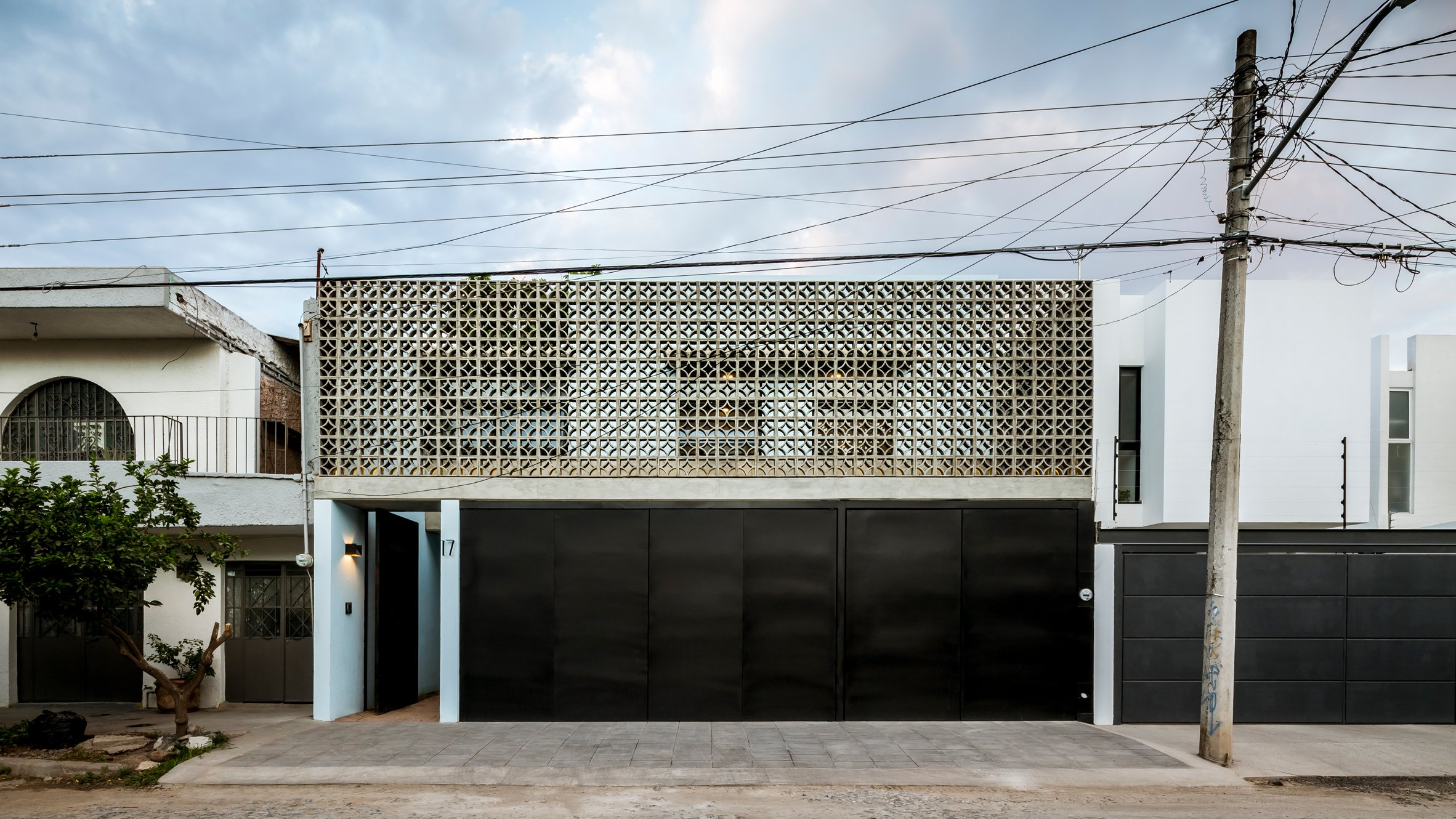 Concrete latticework and two courtyards filter light into Mexican house by  Delfino Lozano
