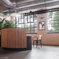 The smooth surface and soft-pink hue of a newly plastered wall provided the starting point for the design of communal spaces at this new creative hub in east London by local studio Sella Concept.