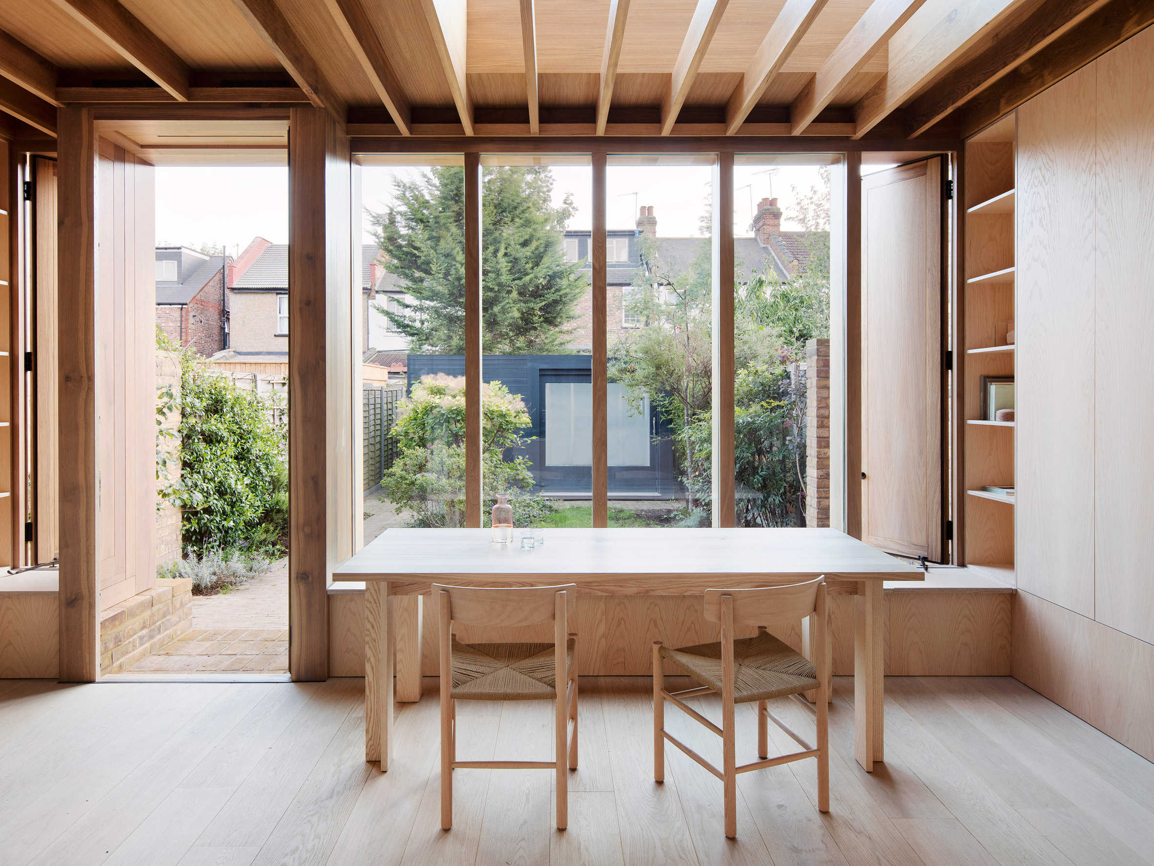 "O'Sullivan Skoufoglou Architects adds ""simple, warm and characterful"" extension to London house"