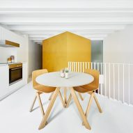 Raúl Sánchez Architects creates duplex apartment with golden cubes at its centre