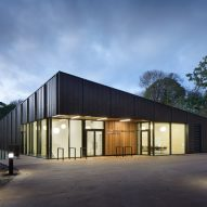 British firm Hawkins\Brown has completed a swimming-pool building at a school in Surrey, England, featuring an exposed timber frame that incorporates windows looking out onto the surrounding woodland.