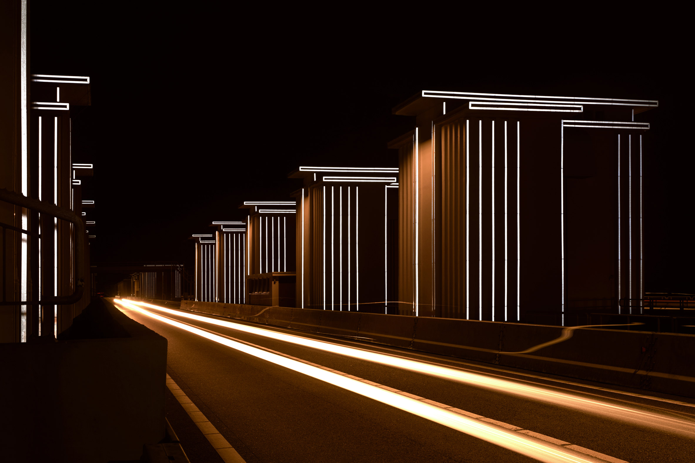 Restored floodgates by Studio Roosegaarde reflect the headlights of passing cars