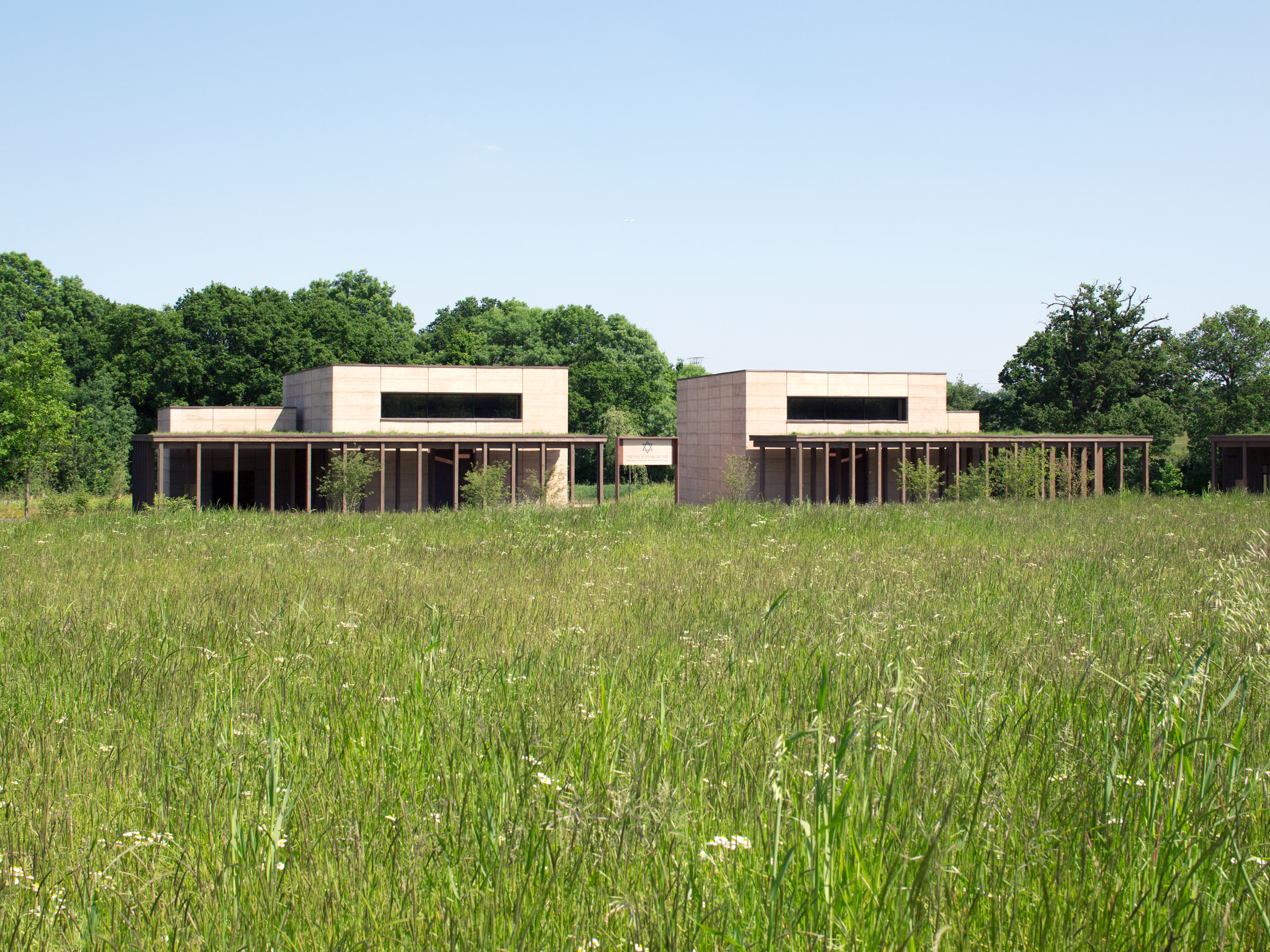 Waugh Thistleton completes cemetery buildings with rammed-earth walls