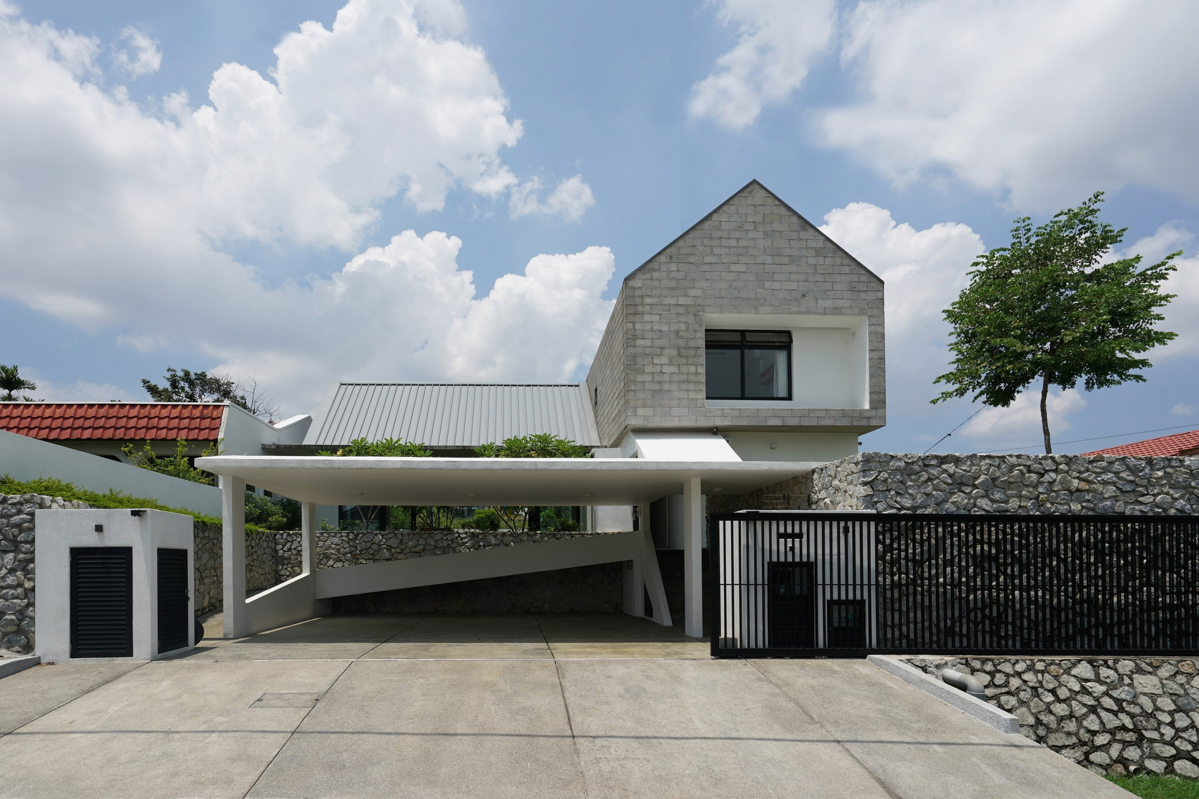Gabled blocks overlook a koi pond at Fabian Tan's Knikno House in Malaysia