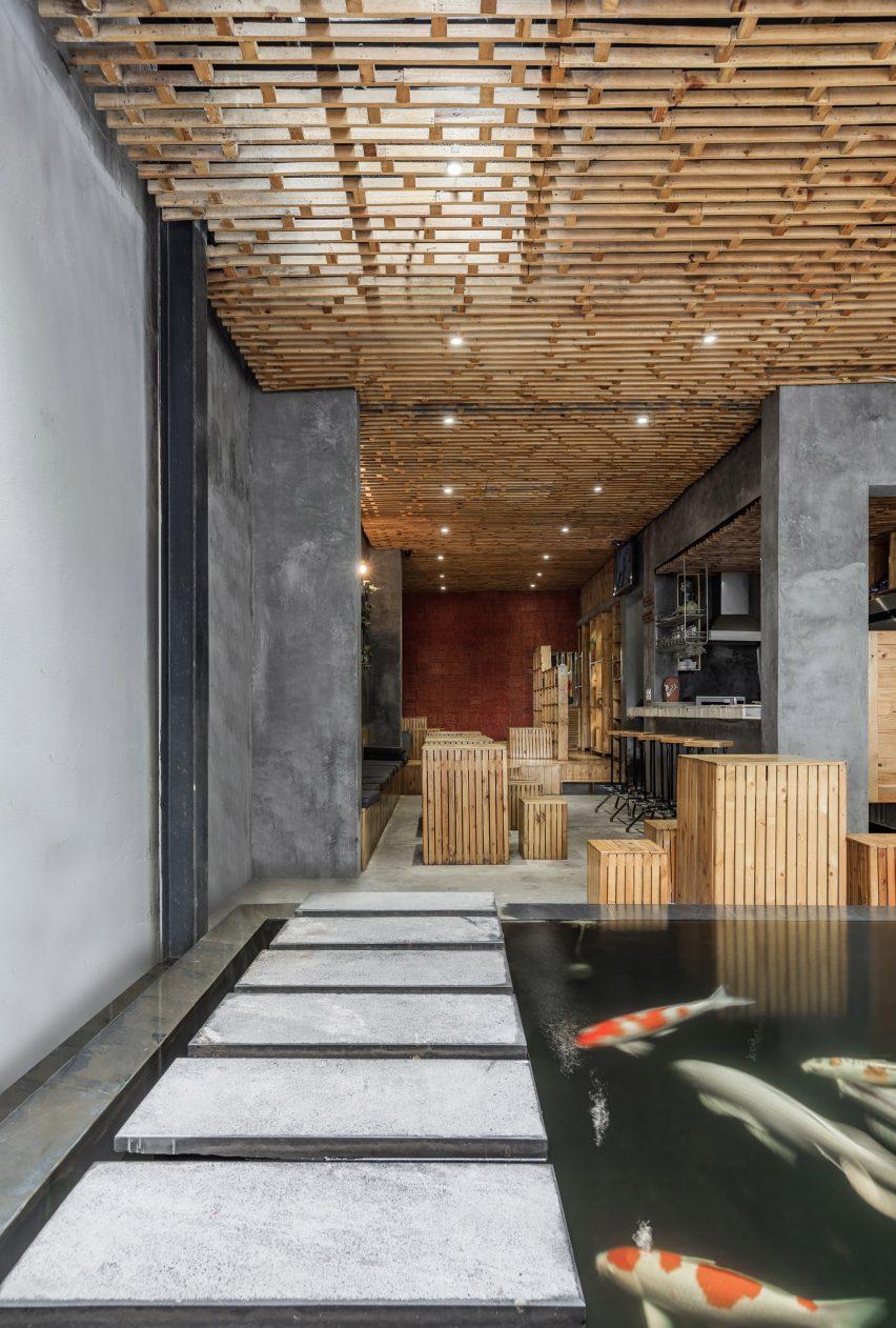 Hanoi Cafe Features Koi Carp Ponds And An Aquaponics Vegetable Patch