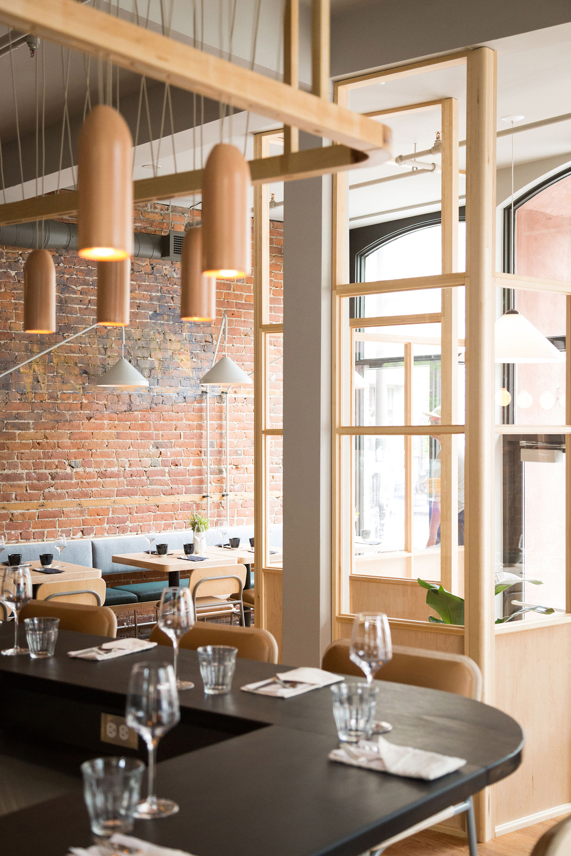 Atelier Filz designs bespoke lighting and chairs for restaurant in Quebec City