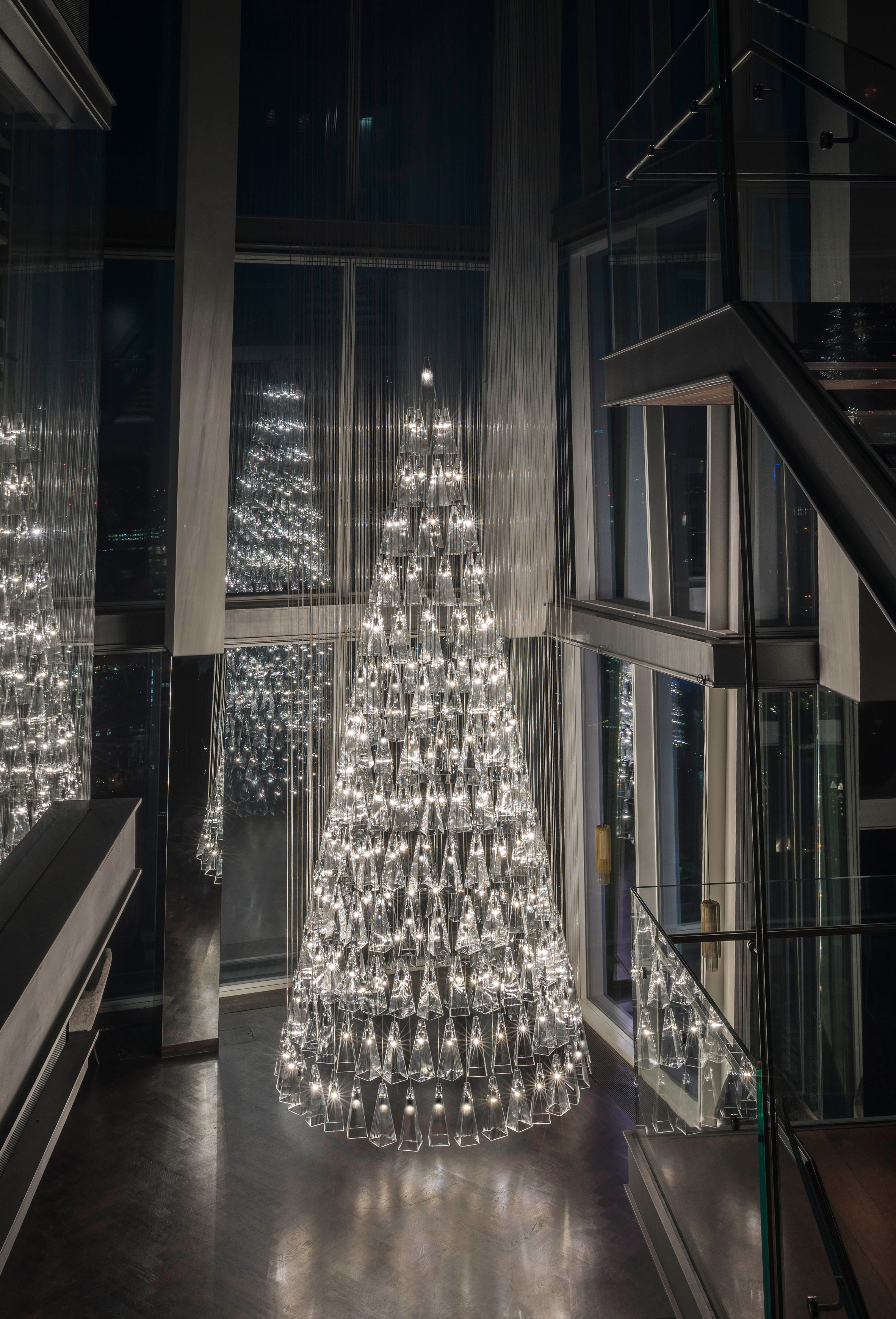 Lee Broom creates Christmas tree from 245 pendant lights inside The Shard