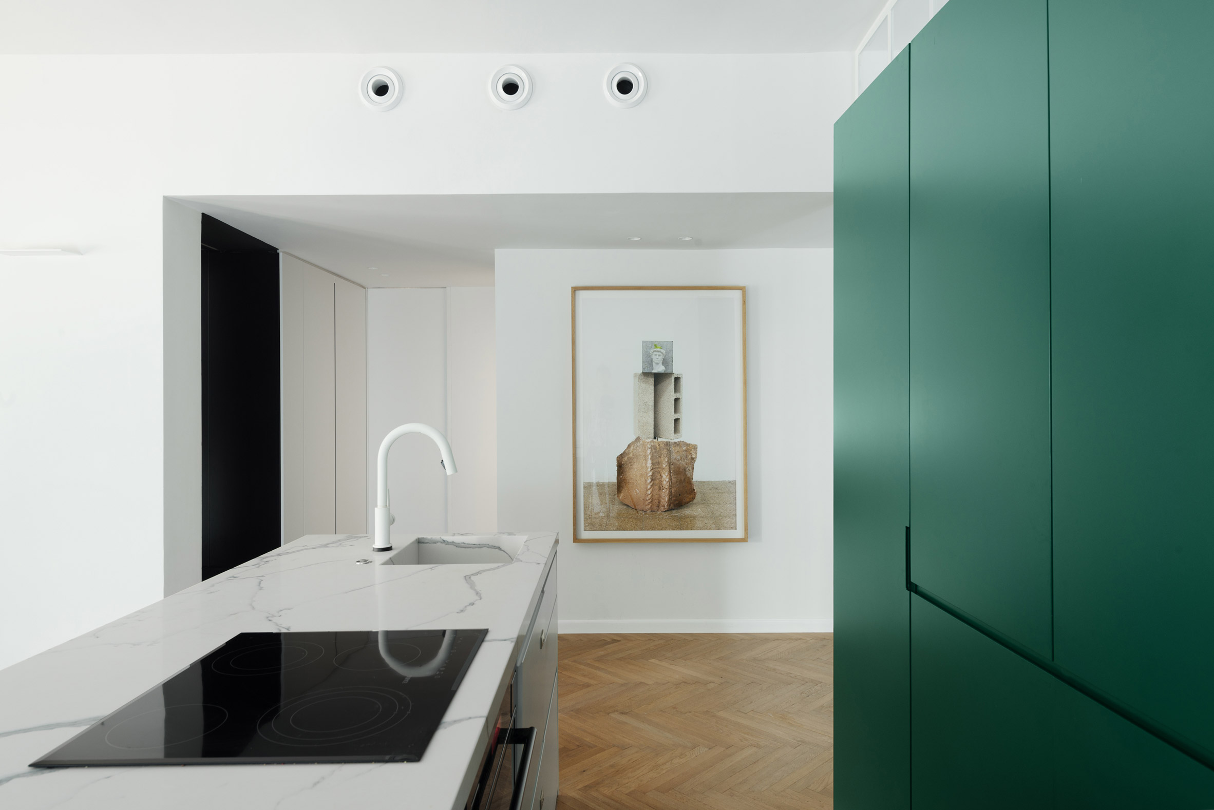Colourful cabinetry offsets white interior of Bauhaus-era ...