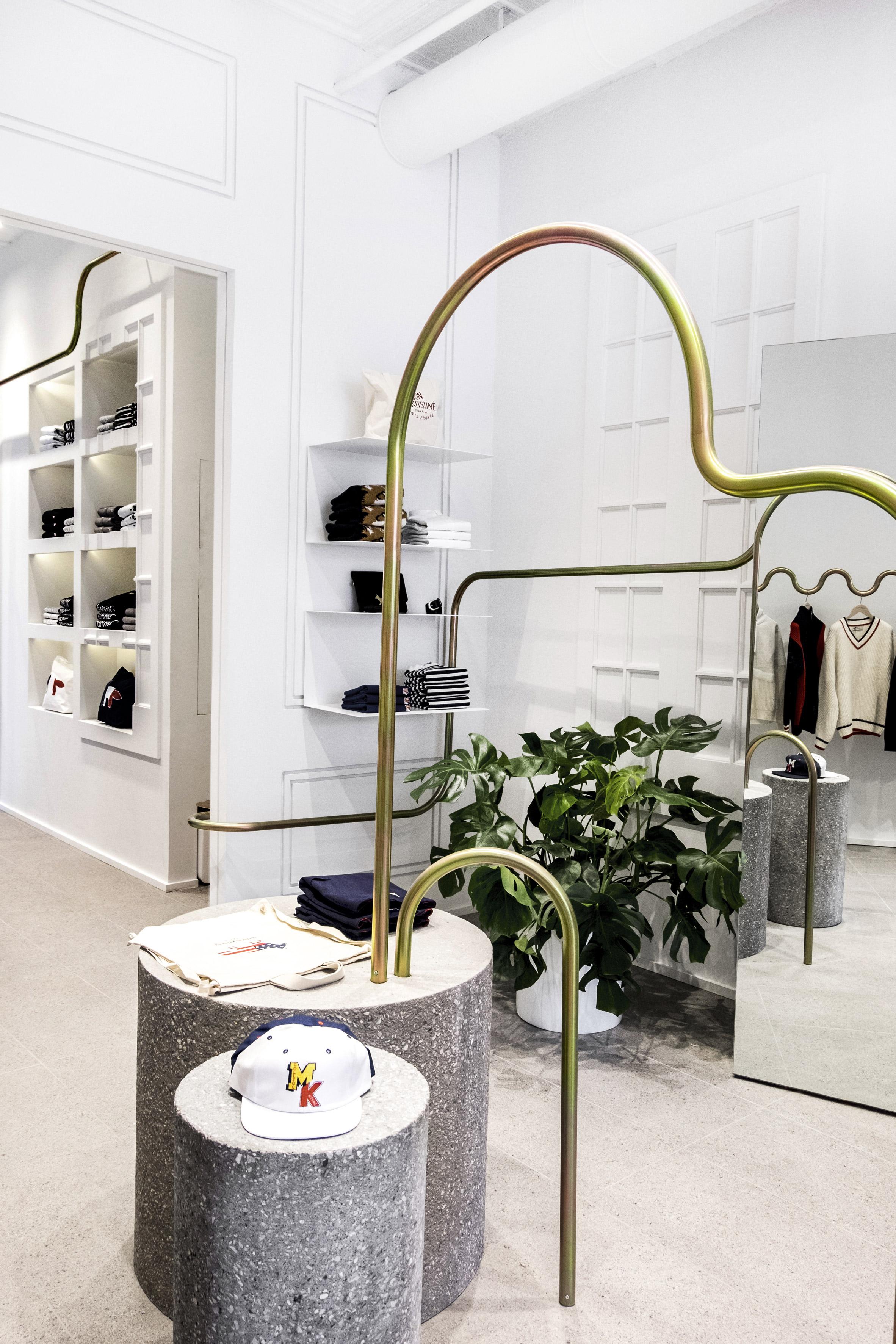 Mathieu Lehanneur snakes metal rails through Maison Kitsuné boutique in New York