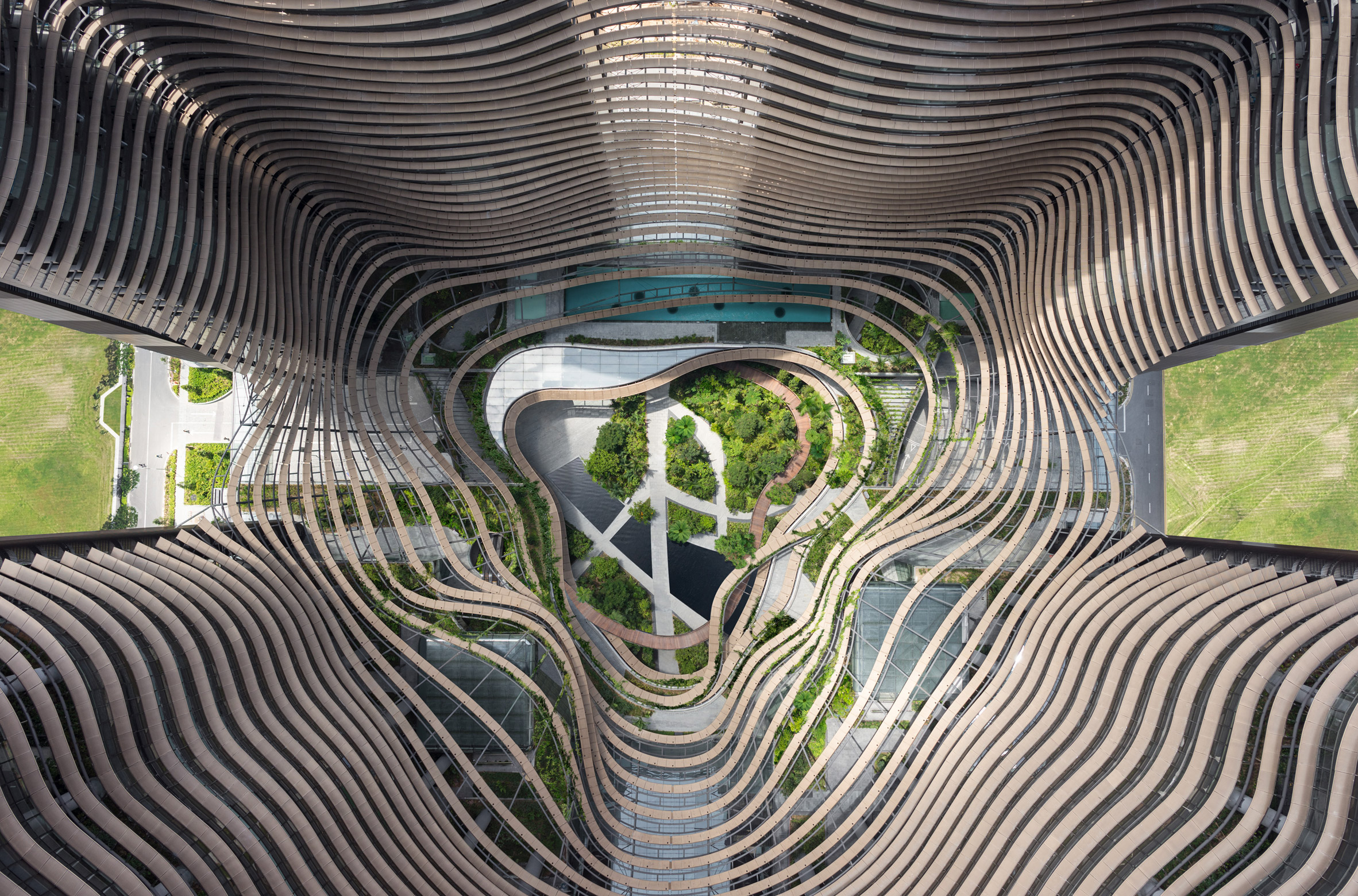 Terraced gardens echoing paddy fields fill centre of Singapore's Marina One