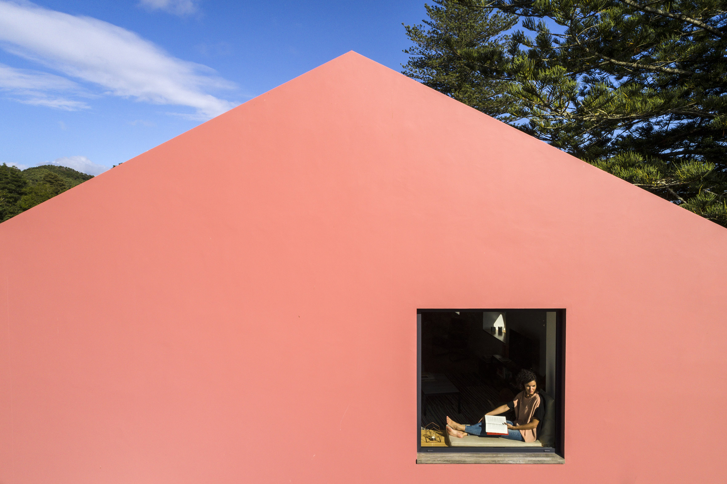 Mezzo Atelier transforms century-old barn into pair of bright pink guesthouses