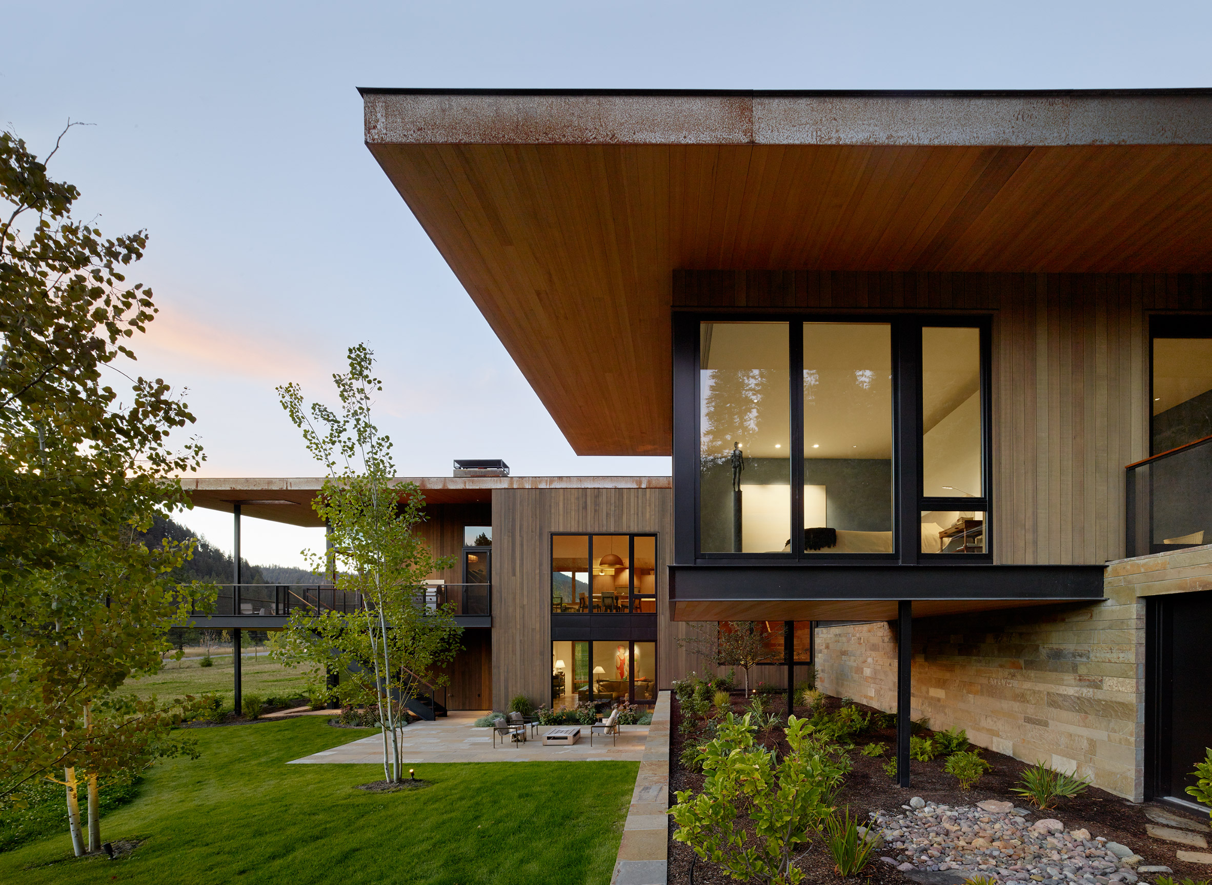 Carney Logan Burke clads remote Montana home in stone and oxidised steel
