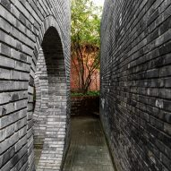 Dong Yugan uses brick to form sculptural surfaces and playful structures at Red Brick Art Museum