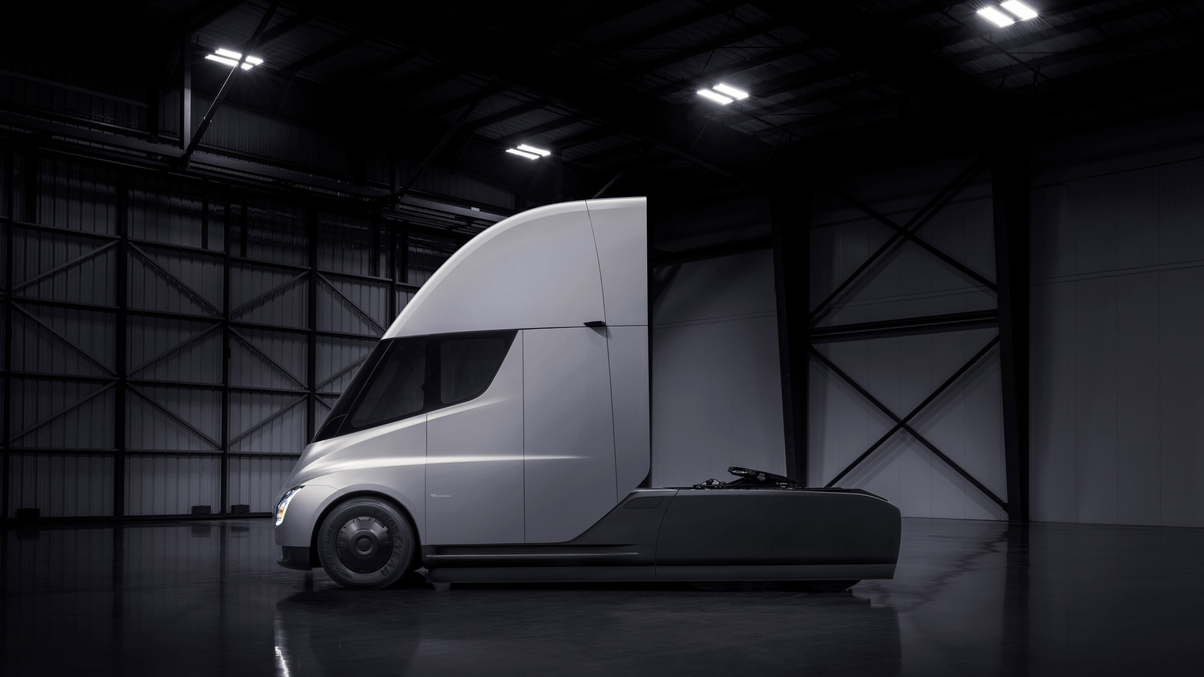 Tesla expands electric-vehicle portfolio with first truck and an updated roadster