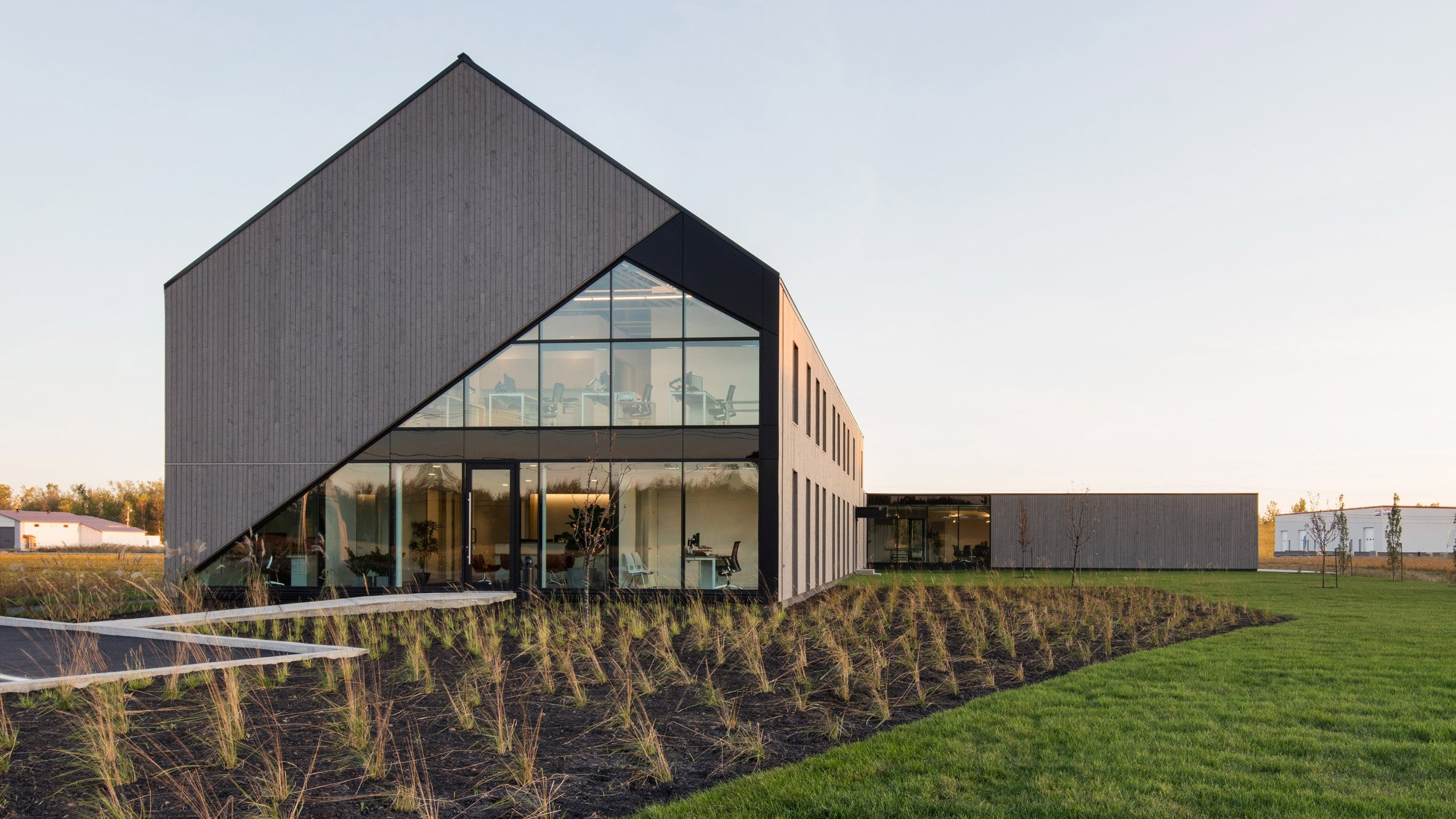 Maurice Martel disguises office building as contemporary barn in rural Canada