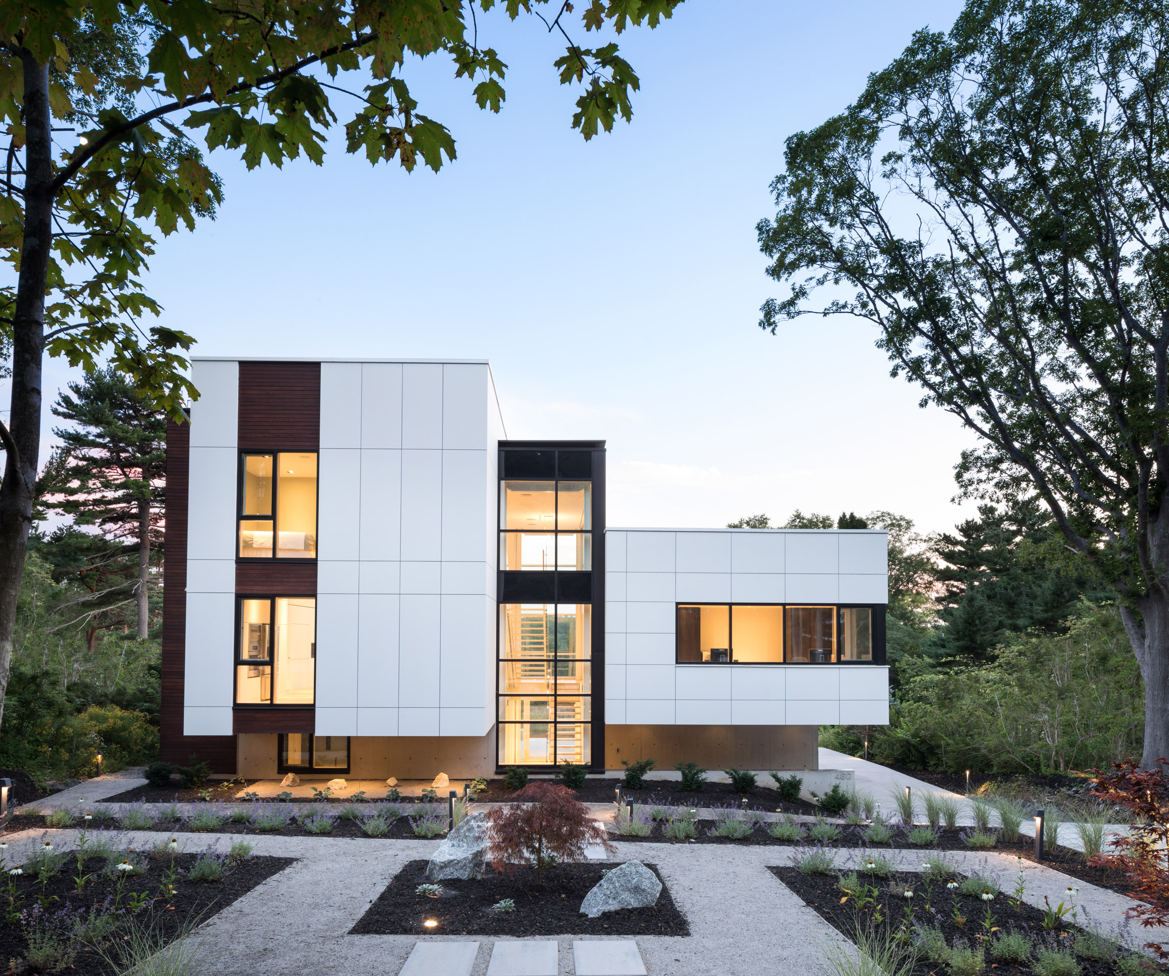 Glazed atrium connects white sides of Halifax home by Omar Gandhi Architect