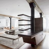 Office of Architecture swaps walls for walnut furniture in Tribeca apartment
