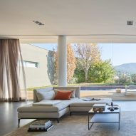 Spanish holiday home by YLAB Arquitectos frames coastal mountain views