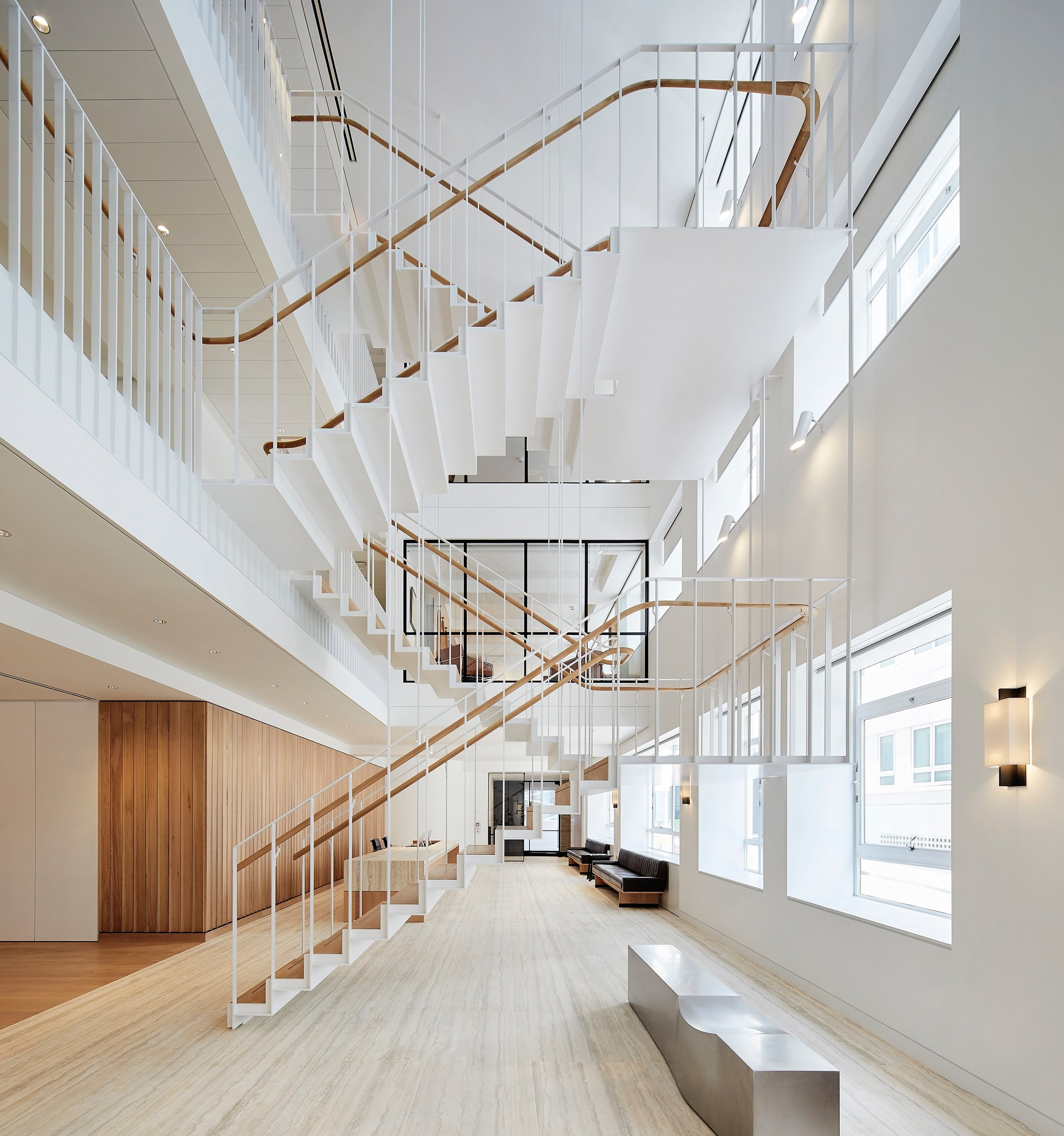 Piercy & Company suspends steel staircase in new atrium of Savile Row office
