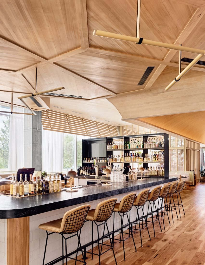 wooden ceiling curves over restaurant in austin by michael hsu rh dezeen com wooden restaurant interior design