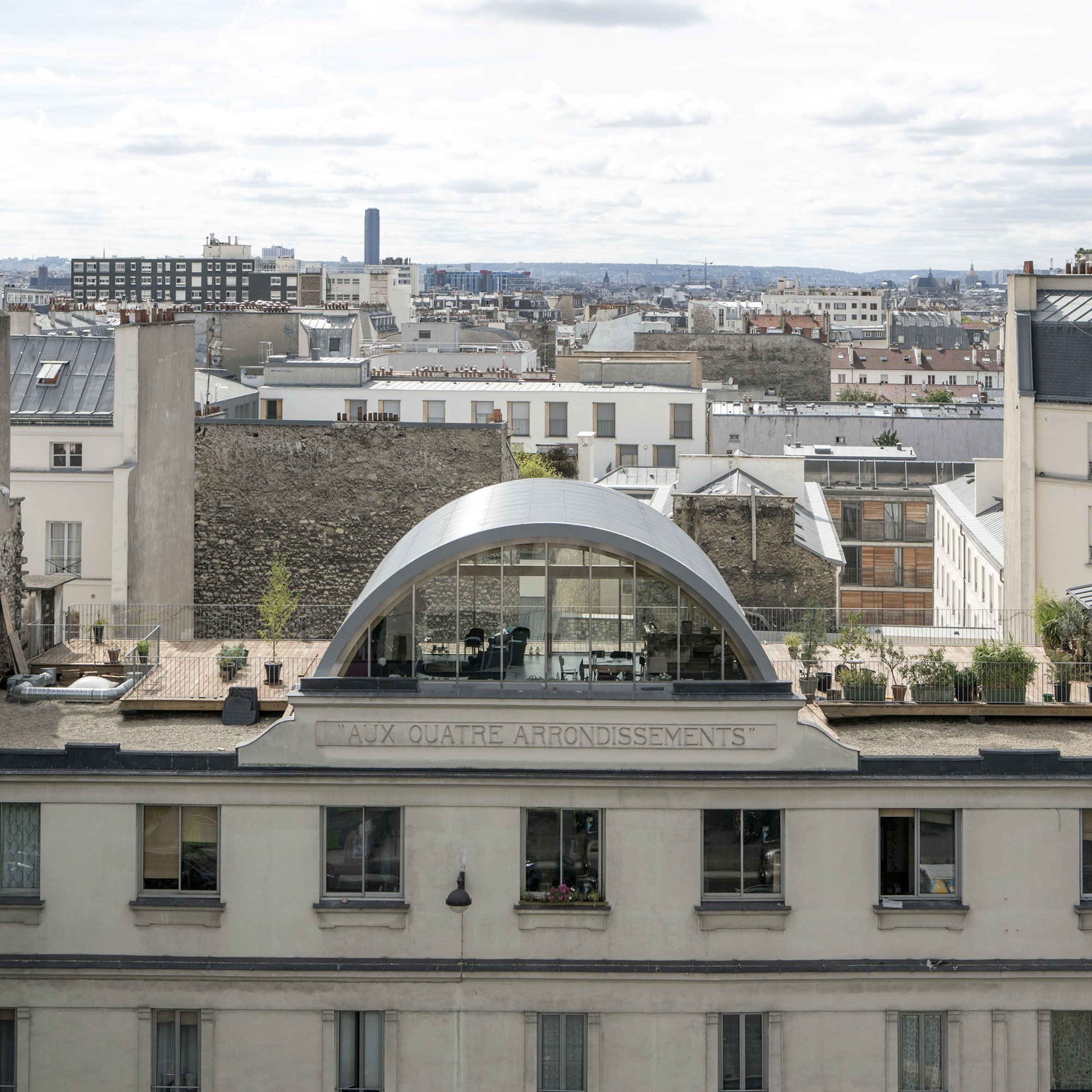 Post Office Architectes Adds Vaulted Roof Extension To Paris Apartment For A Photographer