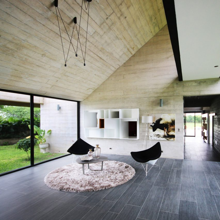 10 home interiors that make use of board-marked concrete