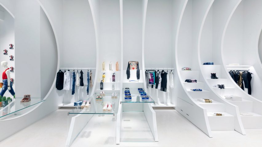 White cut-out panels create displays at Miami boutique by OHLAB