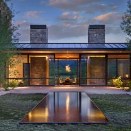 Stone fireplaces anchor Wyoming retreat by Carney Logan Burke