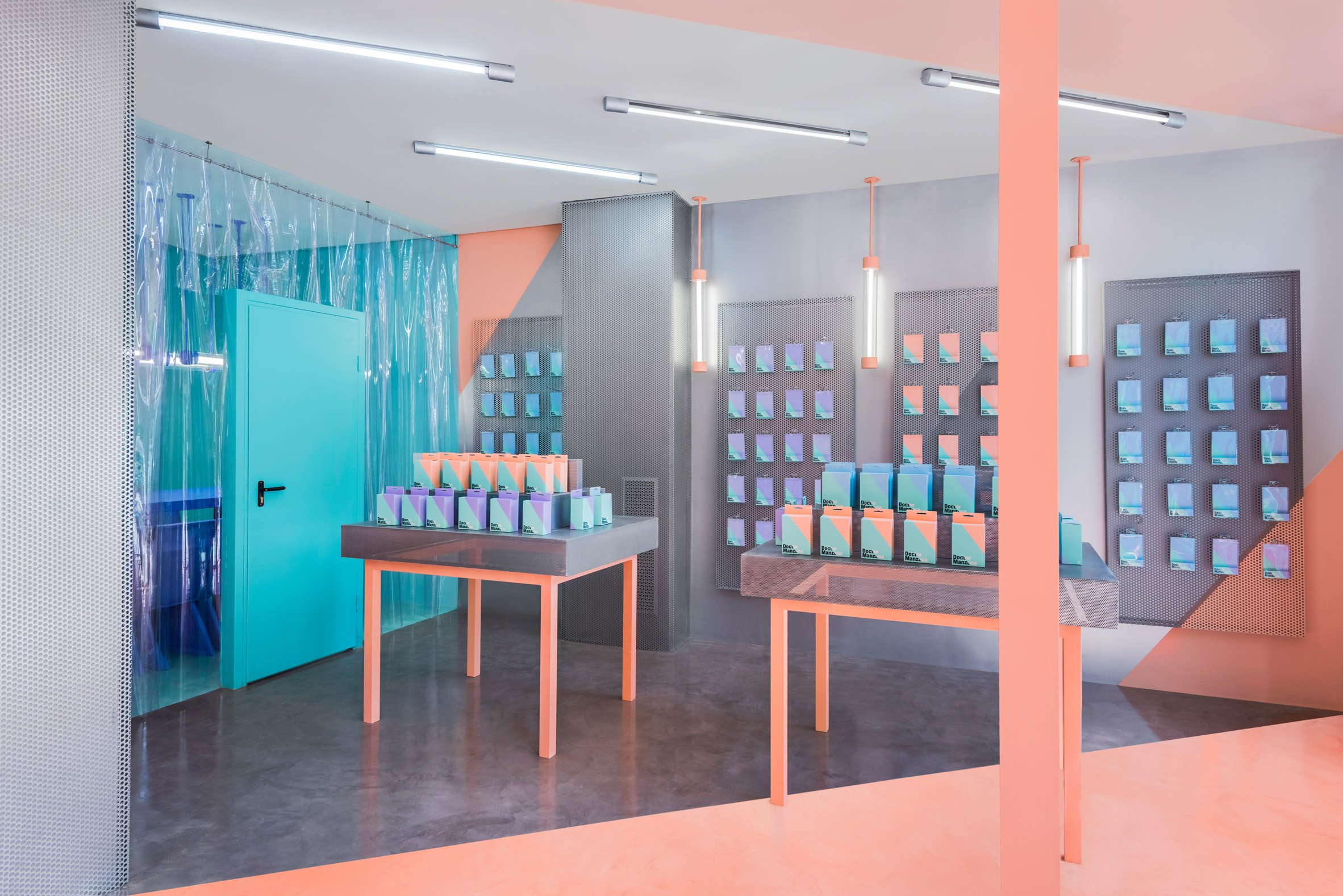 Masquespacio creates colour-clashing interior for phone repair shop in Valencia