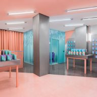 Masquespacio creates colour-clashing interior for phone-repair shop in Valencia