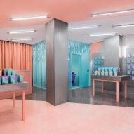 Masquespacio creates colour-clashing interior for phone-repair shop in Valencia