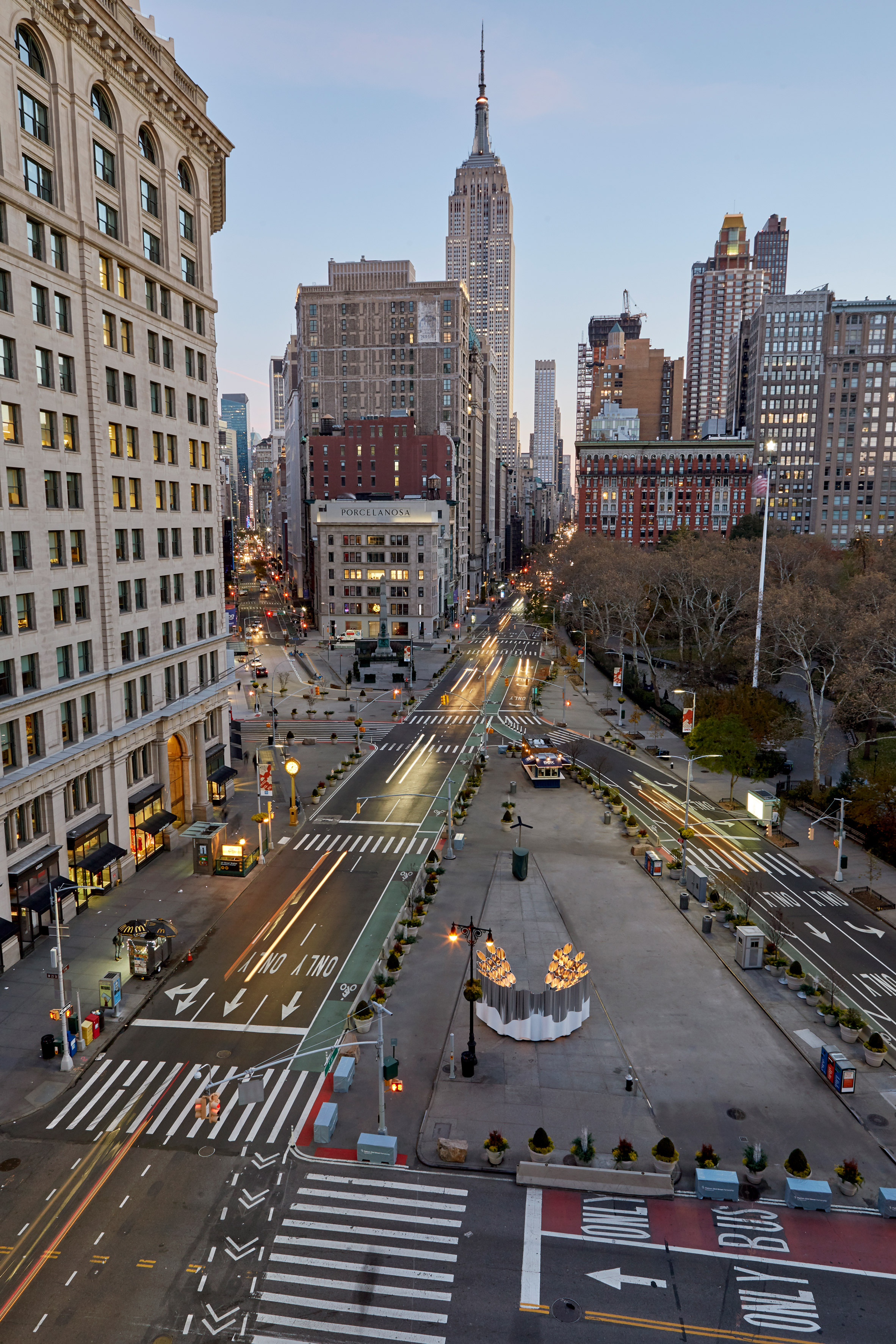 """Future Expansion installs """"choir-like"""" mirrored tubes outside New York's Flatiron Building"""