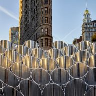 "Future Expansion installs ""choir-like"" mirrored tubes outside New York's Flatiron Building"