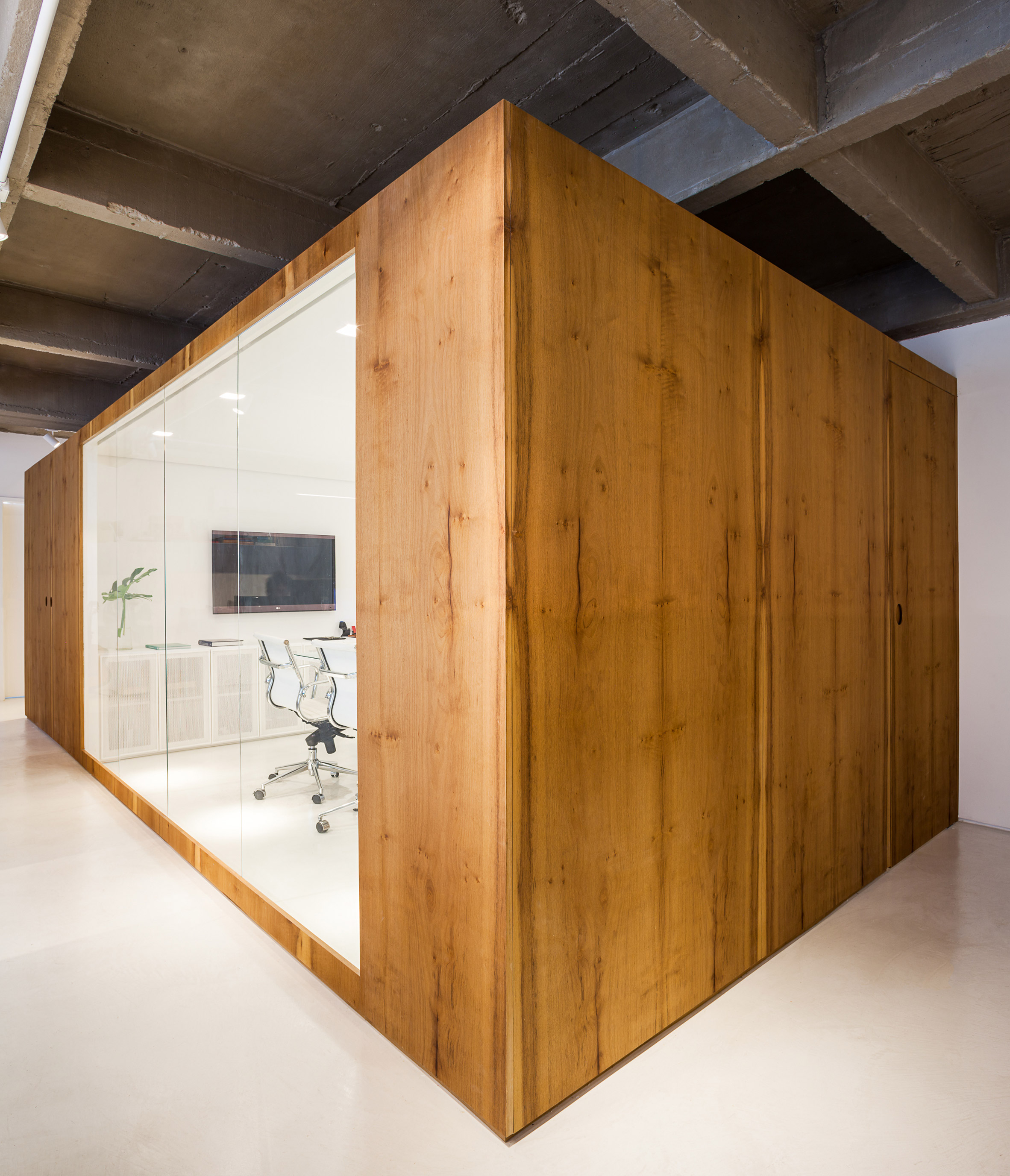 Compact architects' office in São Paulo features wooden meeting cube