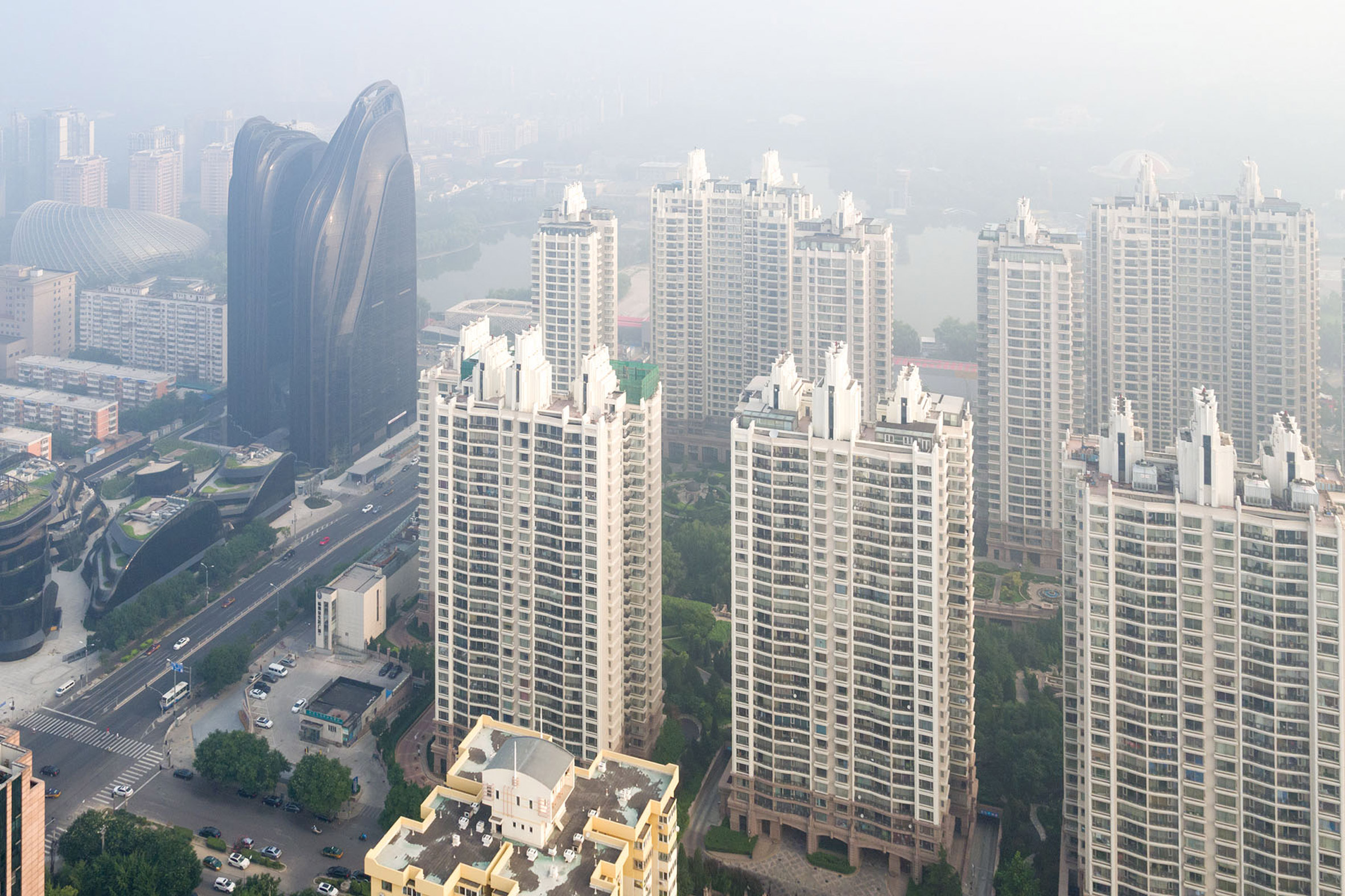 Iwan Baan photographs MAD's Chaoyang Park Plaza in the Beijing haze
